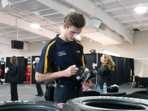 Signing promotional items at the Indianapolis Motor Speedway